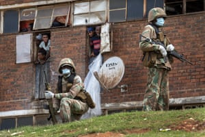 South African soldiers patrol the Men's Hostel in Alexandra, Johannesburg during the lockdown