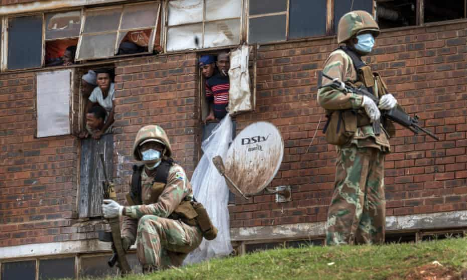 South African troops patrol the men's hostel in Alexandra, a township east of Johannesburg