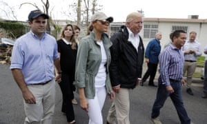 Beatriz Rosselló, second left, walks with her husband, Governor Ricardo Rosselló, and Melania and Donald Trump to survey hurricane damage in Guaynabo, Puerto Rico, last October.