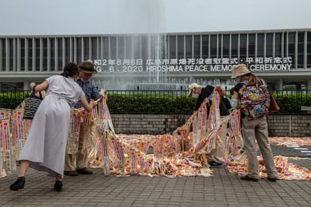 Peace activists arrange ribbons near the Hiroshima memorial museum. About 140,000 people were killed in the bombing.