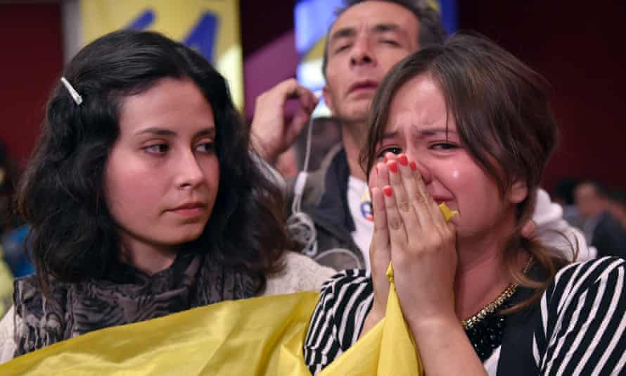 Supporters of the peace deal watch the results of the referendum in Cali on Sunday.
