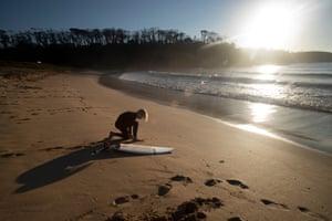 Harry Barrington prepares to enter the water at McKenzies beach