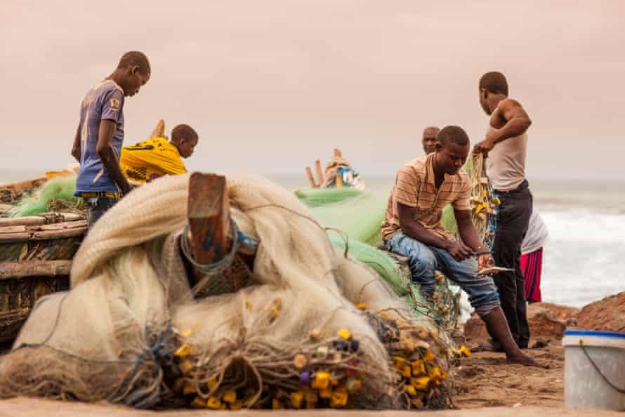 Fishing crew along Kokrobite beach Ghana.