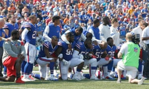 Buffalo Bills players kneel in protest during the National Anthem before a game against the Denver Broncos at New Era Field.