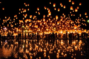 Thousands of people gather in Chiang Mai to release lanterns into the sky at the Yee Peng festival