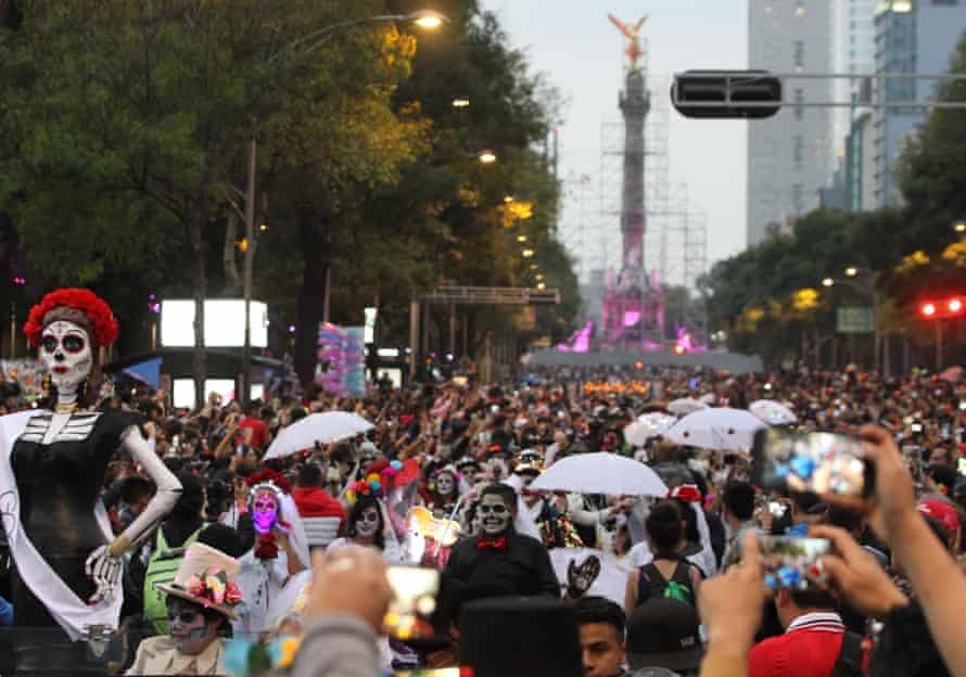 Citizens participate in the traditional parade in honor of La Calavera (The Skull) Catrina, a character first conceived by Mexican artist Jose Guadalupe Posada.