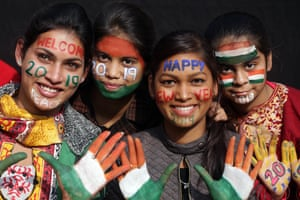 Girls prepare to welcome the New Year in Amritsar in India.