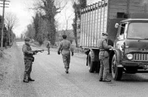 A British border patrol searches a truck in 1969.