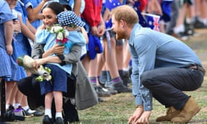 Meghan, the duchess of Sussex, and Prince Harry, the duke of Sussex, greet Luke Vincent as they arrive at Dubbo airport for royal tour