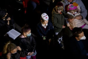 Children attend an open-air service in Berlin. Due to lockdown restrictions, Purim community celebrations have been diverted to online events and within families