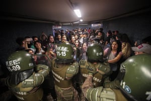 Police close the access to the Los Héroes metro station in the middle of a demonstration in Santiago, Chile.