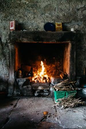 Fireplace with gathered wood, Glendhu Bothy, Scotland.
