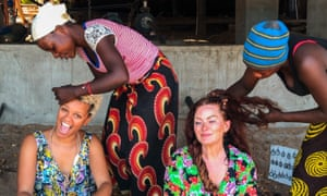 All tied up: Gemma Cairney and friend have their hair braided in Cape Maclear.