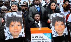 Kye Gbangbola and Nicole Lawler protest over their son Zane's death in 2014.