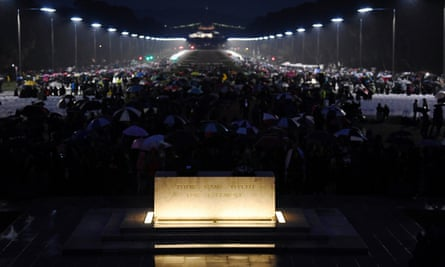People gather around the stone of remembrance at the Australian War Memorial during the Anzac Day dawn service in Canberra.