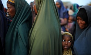 Women and children queue up for food at Dadaab, the world's largest refugee camp which the Kenyan government is threatening to close.