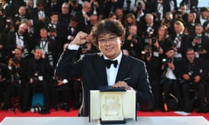 Director Bong Joon-Ho celebrates winning the Palme d'Or for his film Parasite at Cannes 2019.