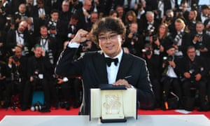 South Korean director Bong Joon-Ho celebrates with his trophy after he won the Palme d'Or for the film Parasite.