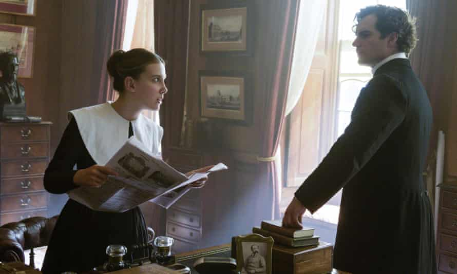 Millie Bobby Brown, left, as Enola and Henry Cavill as Sherlock in Enola Holmes.