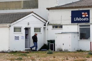 A voter leaves a polling station in Dungeness in Kent.