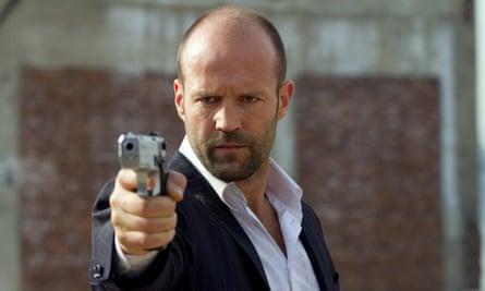 Jason Statham points gun in Safe