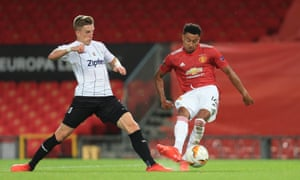 Manchester United's Jesse Lingard of Man Utd scores their equaliser despite the efforts of Philipp Wiesinger of LASK.