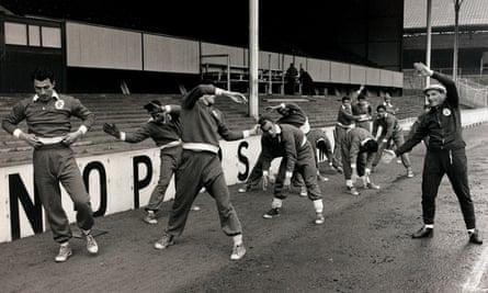 Béla Guttmann, right, prepares his Benfica players for their European Cup semi-final second leg at Tottenham in April 1962.
