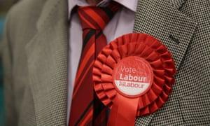 A man wearing a Labour rosette.