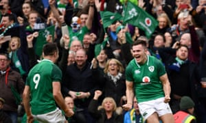 Ireland's wing Jacob Stockdale celebrates with Conor Murray after scoring his side's second try during the victory over Scotland, which proved enough to seal the Six Nations title.