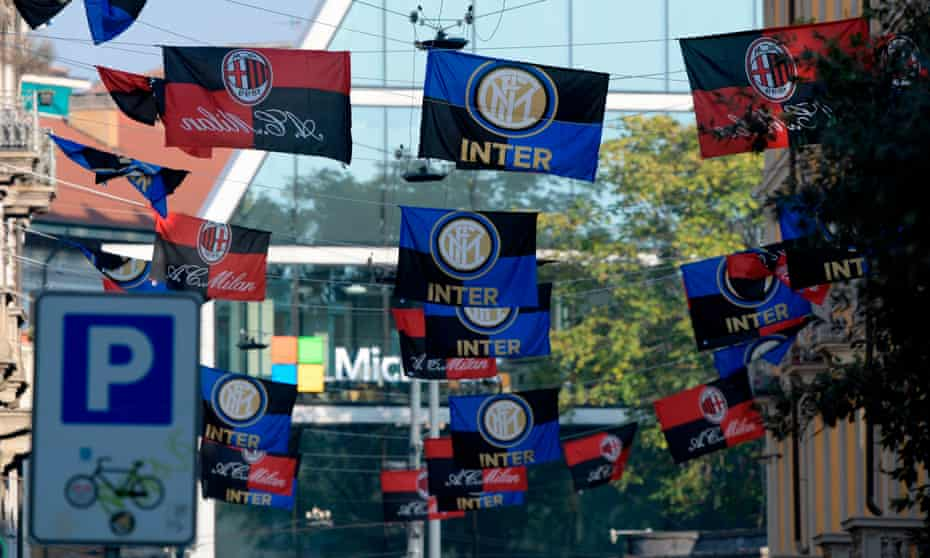 Inter and Milan flags fly in the city on derby day.