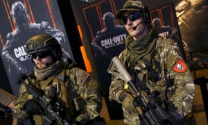 Men are dressed as soldiers to promote the video game Call Of Duty Black Ops 3
