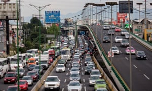 Cars sit in traffic in Mexico City, Mexico