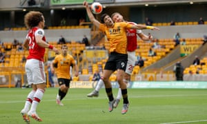 Raul Jiminez of Wolves and Shkodran Mustafi of Arsenal go up for a header.