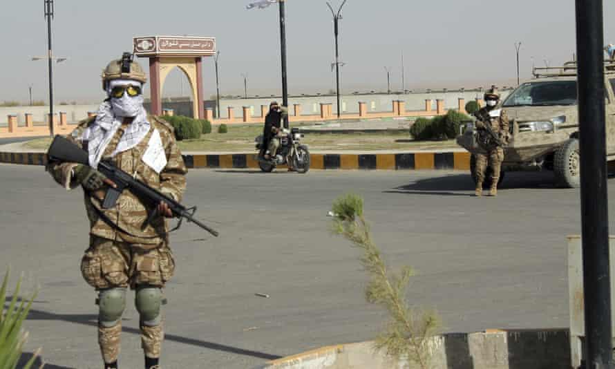 Taliban commando fighters stand guard in Lashkar Gah on 27 August 2021.
