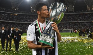 Cristiano Ronaldo holds the Supercoppa Italiana – his first piece of silverware for Juventus.