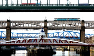Trains and a bus cross the River Tyne in Newcastle