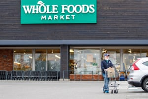"""Workers at Whole Foods organized a """"sick-out"""" protest to demand better pay and benefits during the coronavirus pandemic."""