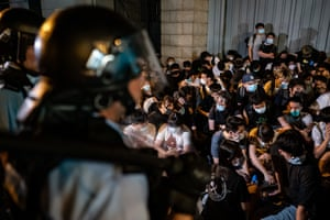 Demonstrators are detained during a clash as tensions escalated