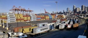 Loaded container trucks line up at a gate at the port of Seattle as the facility reopened following in February a labor dispute.