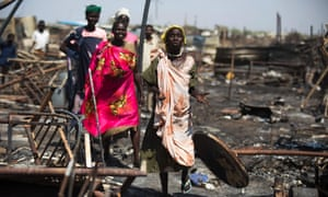 Women search for their belongings after the protection of civilians site in Malakal was burnt and looted