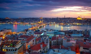 Istanbul at twilight with the Bosphorus flowing through its centre.