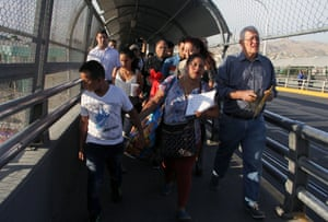 Ruben García, right, from the network of Casa Asención - Annunciation House - shelters across El Paso, accompanies migrants seeking political asylum in the US, in Ciudad Juàrez.