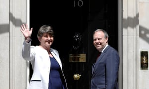 The leader of the Democratic Unionist party, Arlene Foster, and the deputy leader, Nigel Dodds, on the steps of 10 Downing Street