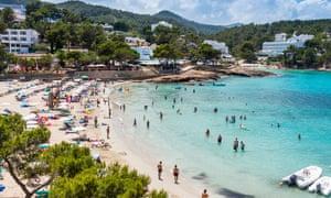 People on the beach in Ibiza, Balearic Islands, Spain,