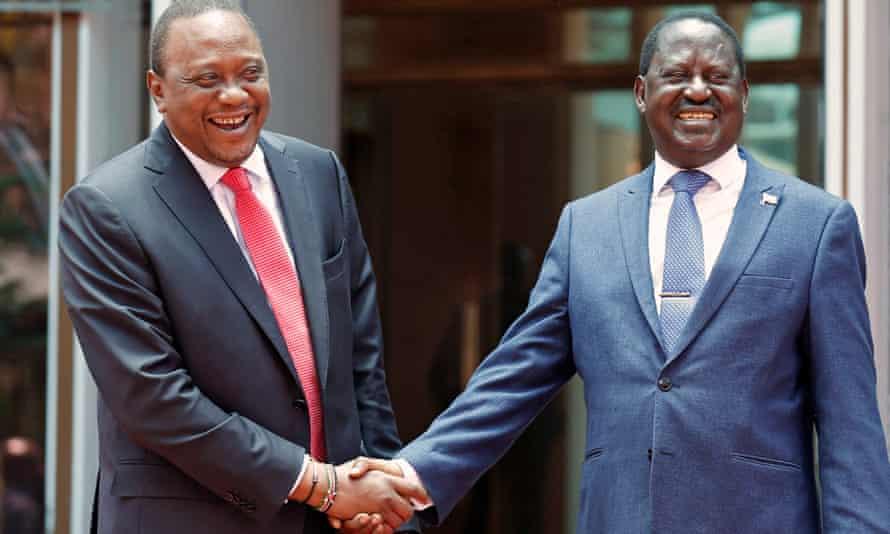 Uhuru Kenyatta, left, greets Raila Odinga at the president's Nairobi office