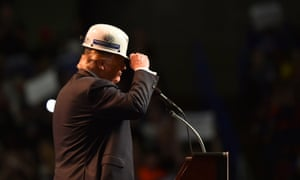 Trump wears a coalminer's hard hat while addressing his supporters at a rally in West Virginia in 2016.