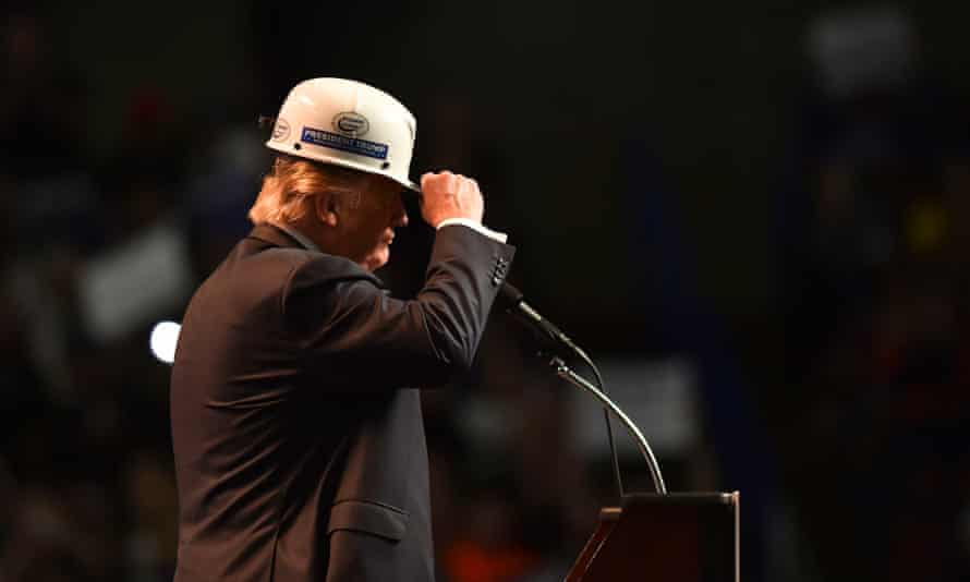Donald Trump wears a coal miner's protective hat while addressing his supporters during a rally at the Charleston Civic Center on May 5, 2016 in Charleston, WV.