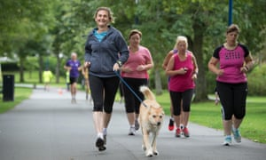 Women jogging with dog