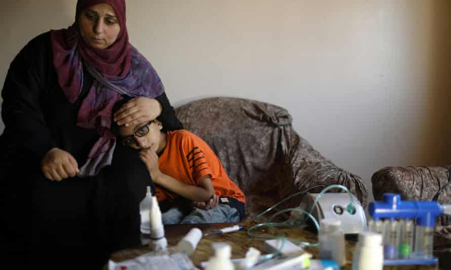Mohammad Shanty, who suffers from cystic fibrosis, sits next to his mother