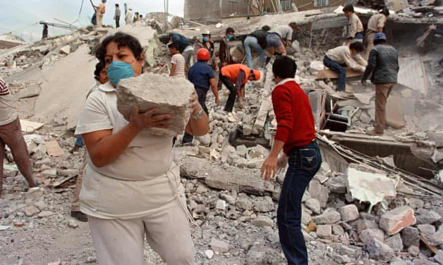 Rescue workers and volunteers sift through the rubble of a collapsed building in Mexico City.